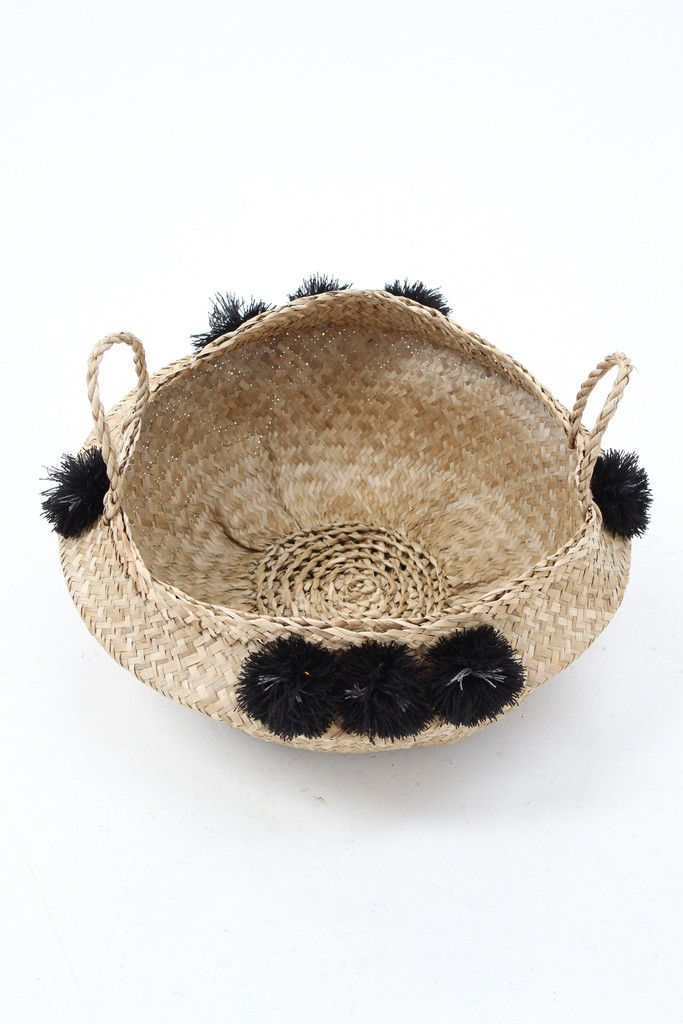 """We love these! They are soooo good. Low straw basket with colorful pom poms. 2 handles & aprox. 18"""" X 9"""" Baskets are handmade and one of a kind. Perfect for so many things from magazines, to laundry,"""