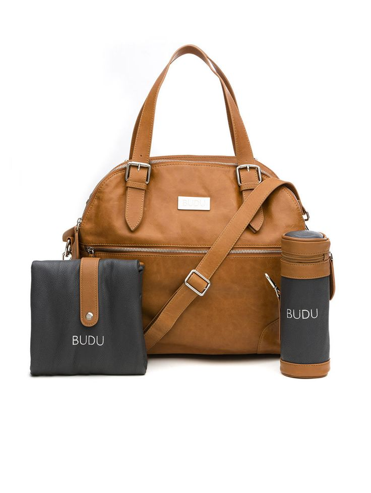 Budu Baby Bag in tan leather. Comes with insulated bottle holder, padded change mat, pram strap, leather key clip, removable lining and plenty of storage.