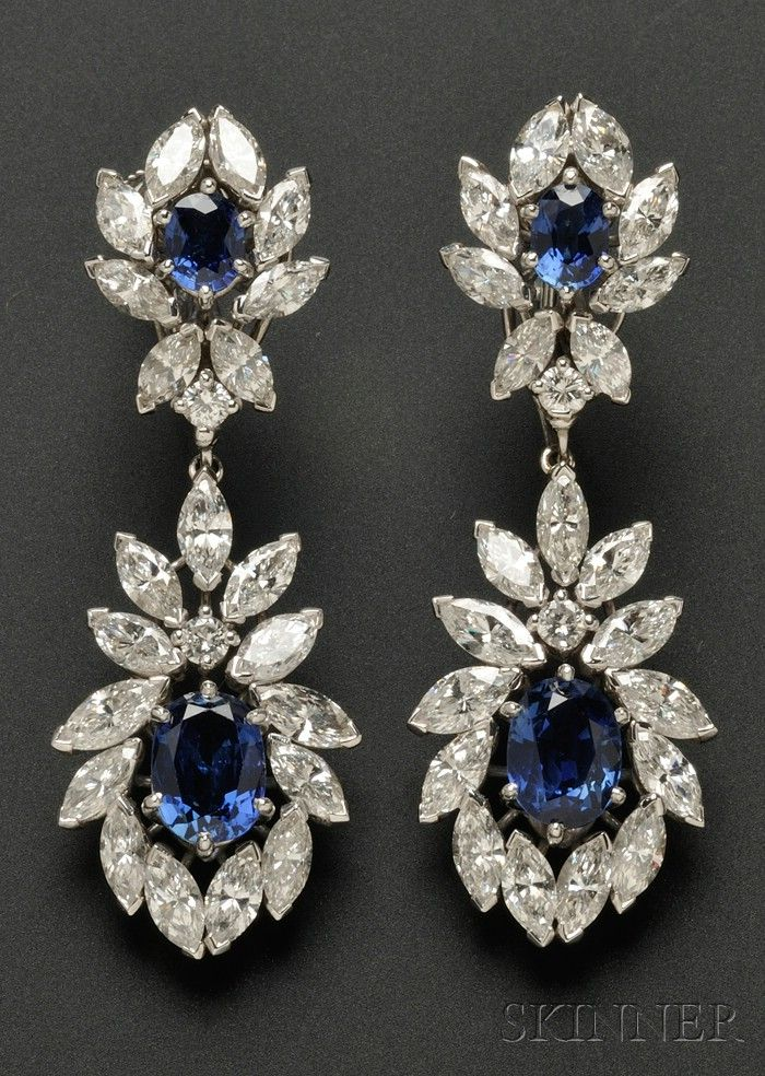CARTIER Platinum, Sapphire, and Diamond Day/Night Earpendants, set with cushion-shape sapphires framed by marquise and full-cut diamonds, approx. total wt. 7.38 cts., lg. 2 in; purchased in the 1970s