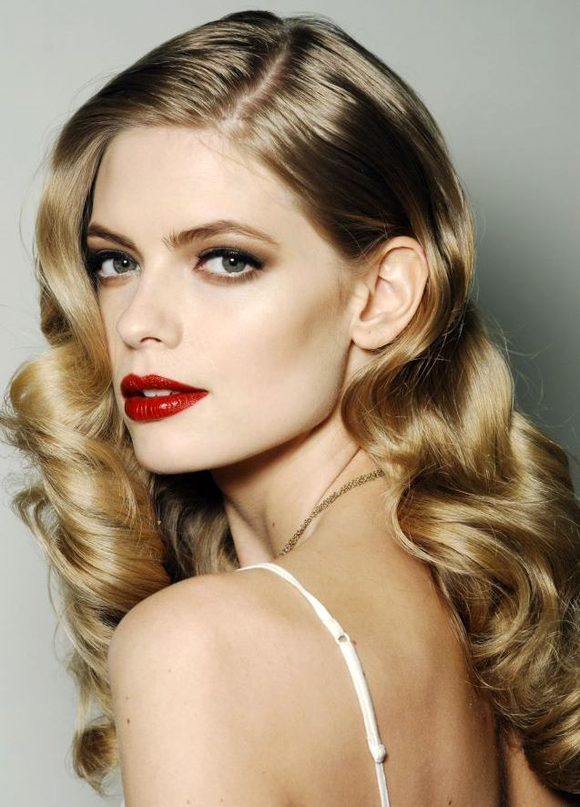 perfect elegant hair and makeup. wavy curls, soft smoky eye, with upper lashes lined with black liquid liner and red lips
