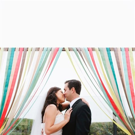 I feel weird pinning other people's wedding photos, but i like this homemade ribbon arch thing