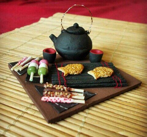 Miniature japanese tea set with japanese sweets