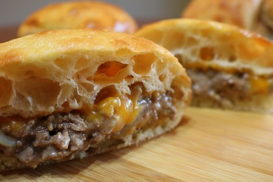 Cheesy Venison on Ciabatta- Fried ground venison with chunks of onion and celery, mixed with cream of celery soup, topped with cheddar cheese, and toasted on a buttery Ciabatta roll. #DeerRecipes #Sandwiches #cheesy #venison #deer #recipes #delicious #yummy #ciabatta