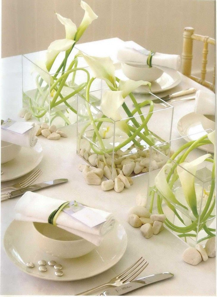 Modern White Wedding Centerpiece Ideas.  Pinned by Afloral.com from http://vilalala.com/creative-centerpieces-in-the-home-interior/white-flower-centerpieces/ ~Recreate this look.  Use the Clear Glass Cube Vase from Afloral.com, fill the bottom with stones and add high-quality faux calla lilies.