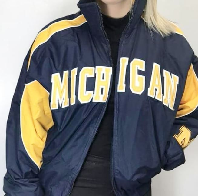 Make a statement with this vintage Michigan jacket! One of the many new pieces hitting the floor, get it here only at Plato's Closet Cambridge! #majestic #platosclosetcambridge #vintage #gentlyused #retro #lit | www.platosclosetcambridge.com