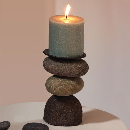 """River Stone Candle Holder - Beautiful Hostess Gift by ancient graffiti. $28.50. Mix of Steel And Stones. Beautiful Washed River Stones. Unique and Rustic Look. Generously sized. Beautiful Washed River stones make up this unique candle holder.  Mix of steel and stones (candle not included) 4"""" x 6"""""""