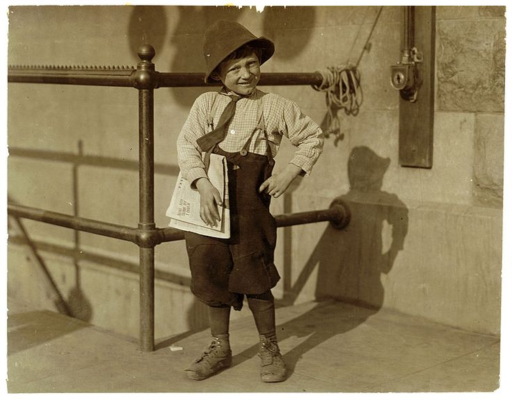 6 year old Luigi, a newsboy beggar working the public. See California report. Location: Sacramento, California. Photograph by Lewis Wickes Hine, May 1915.