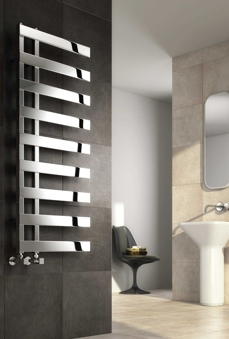 Reina Capelli Stianless Steel designer heated towel rail. The Illusions collection of Stainless steel radiators from Reina offer the very latest in hand-made modular radiator construction, the most sophisticated finishing and fresh & innovative designs. Can be mounted with the arms going to the left or right hand side. Available in polished stainless steel. Complete with a 25 year guarantee. Prices from £339.76!