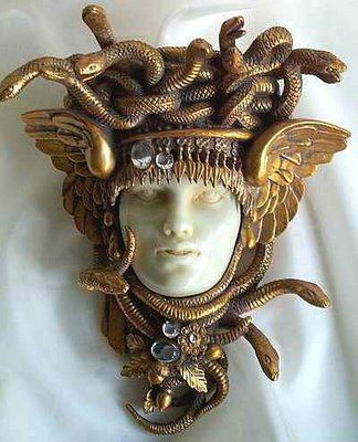 Elegant Medusa pin. She is often depicted with wings to the side of her head in Greek and Roman artwork.