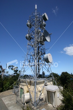 Picture of a communications mast against a blue sky