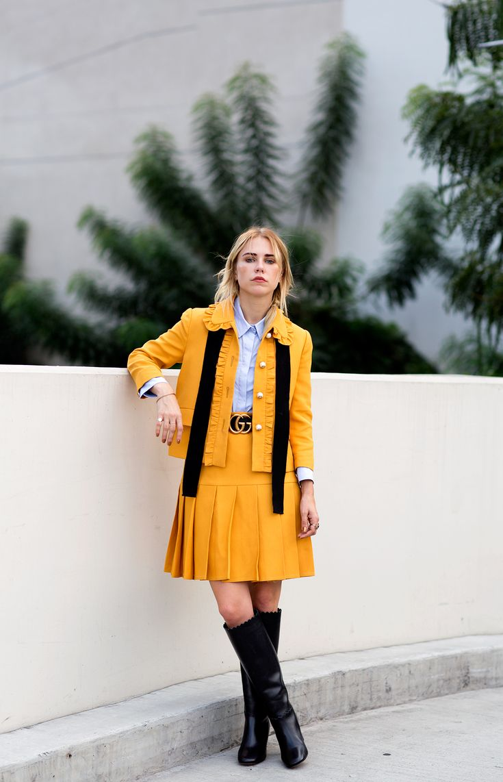 A honey crêpe wool mini skirt suit finished with pearl GG buttons.