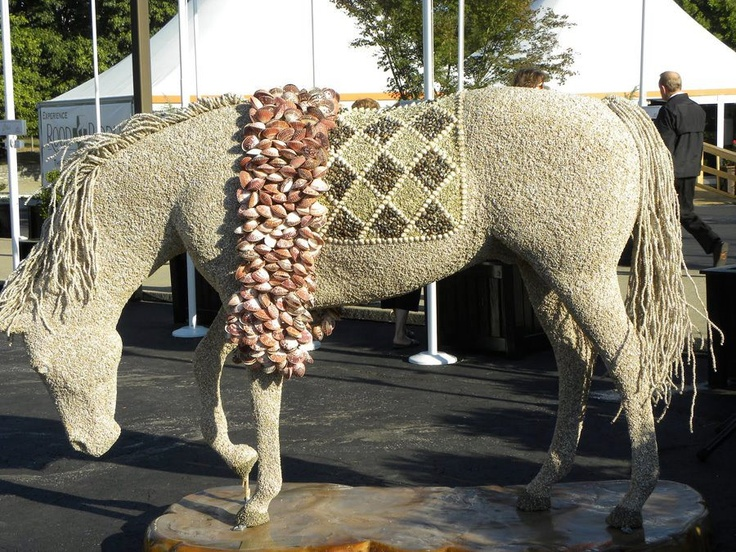 REPIN it if you love it! This gorgeous creation is made entirely of seashells!