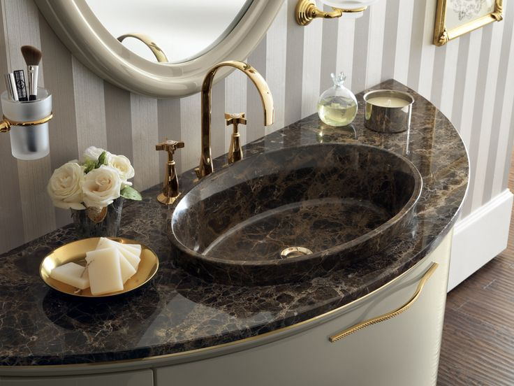 Emperador marble for the top and oval tabletop washbasin. Classic #design for a special #bathroom.