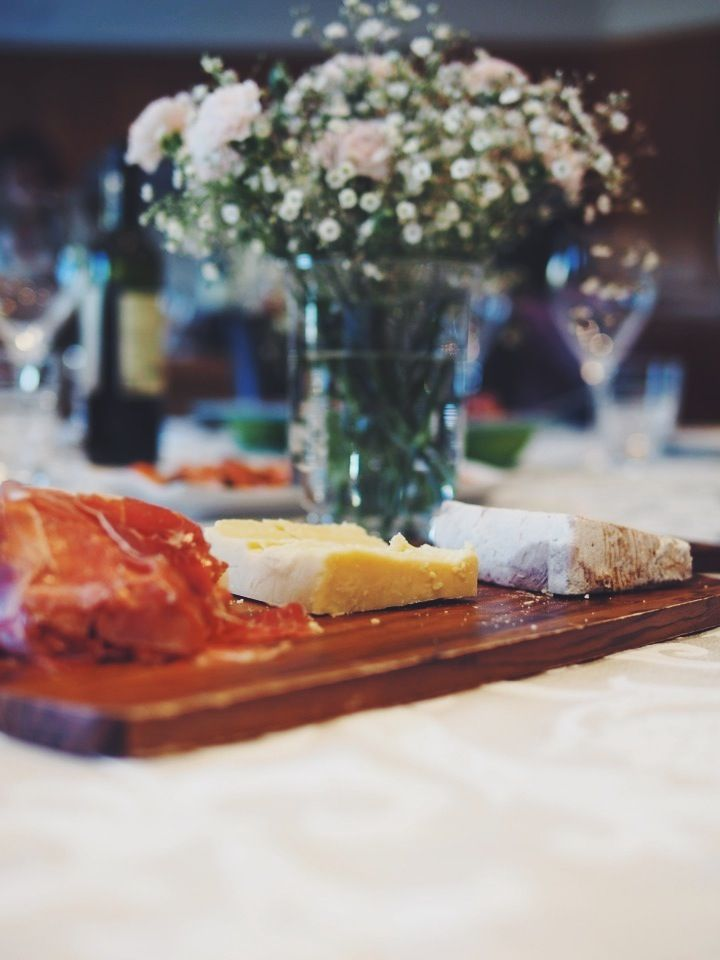 Photo by Jessica Totino. Sunday lunch. Cheese platters and flowers.
