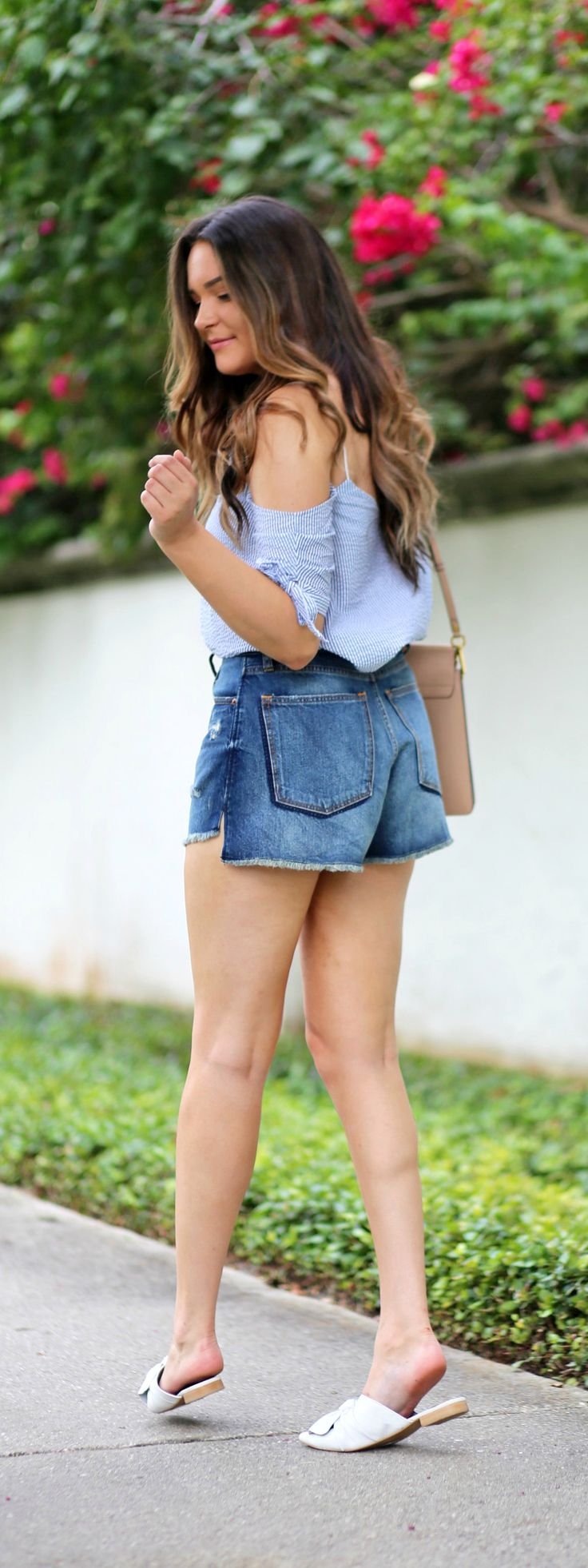 The perfect jean shorts! | Fashion blogger Mash Elle styles a blue striped seersucker off the shoulder top from Urban Outfitters  with high waisted cut off ripped jeans short from Abercrombie and Fitch shorts, Michael Hill watch, and Chloe Faye purse.