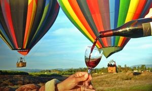 Groupon - $ 264 for a Sunrise Balloon Flight for Two or Four-Hour Winery Tour for Two at Uncorked Tours ($438 Value) in Temecula. Groupon deal price: $264