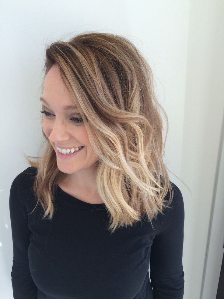 Balayage blonde ombré cut and styled into a blunt long textured bob with deep side part