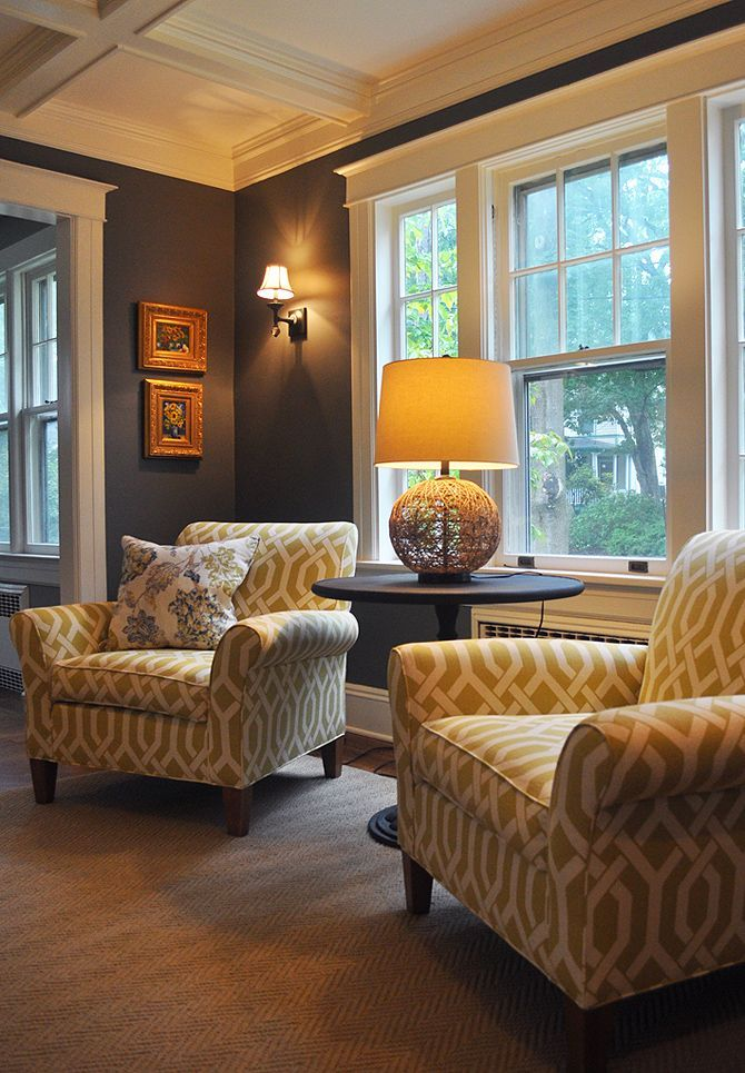 Family room - Love the wall color + patterned chairs