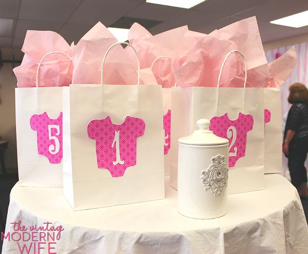 These prize bags at the pink baby shower for The Vintage Modern Wife are so adorable. Love that the winners have to draw their number to pick their prize