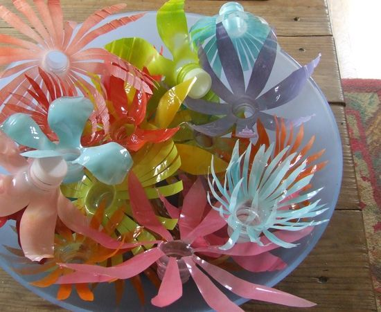 I've been looking for some old fashion plastic flowers...these are one-ups for recycling plastic bottles! Yeow!