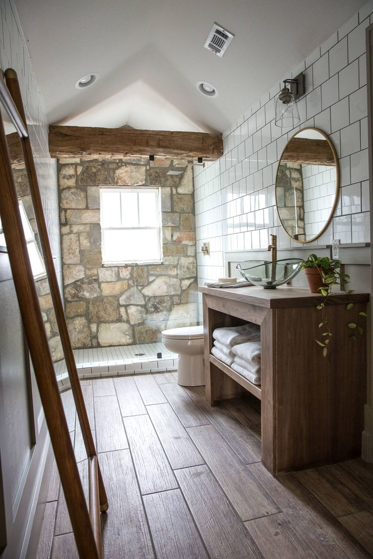 Big master bathroom ideas - This Bathroom Is Dreamy I Love That The Stone In Here Matches The Stone On The Exterior Of The Home And The Beam Matches Perfectly To The The Beams In The