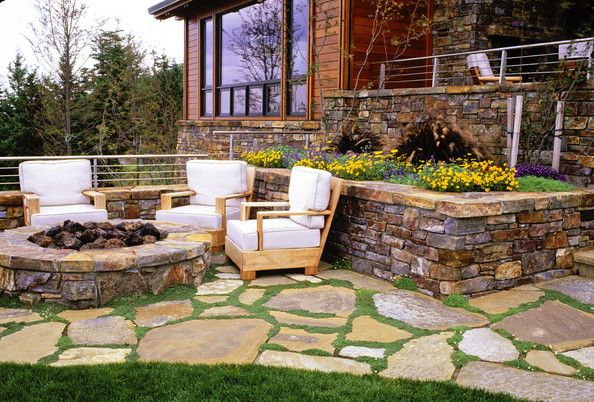 Fire pit, crazy pavers, flowers, yard. Beautiful! This is what I want my patio to look like.
