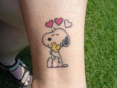 If I were to get a snoopy tattoo id get thus one...without the hearts