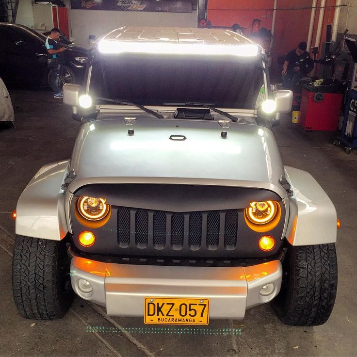 Amber Halo Color Changing headlights on JK with custom fit light bar! Visit us!