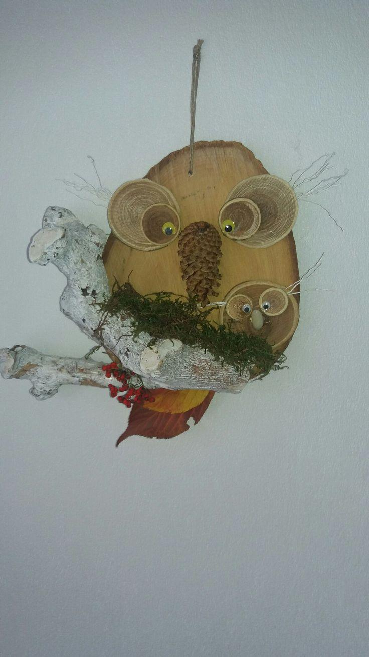 Uil gemaakt van een boomschijf