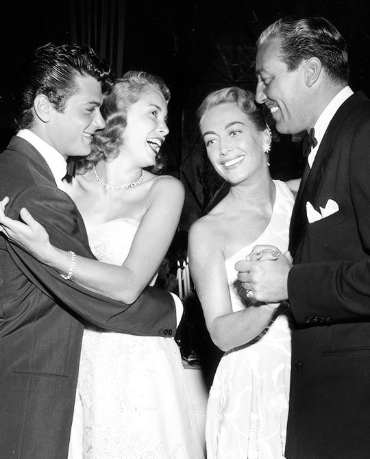 Joan Crawford and Cesar Romero with Tony Curtis and Janet Leigh during a Damon Runyon Cancer Foundation benefit at the Mocambo nightclub, 1951