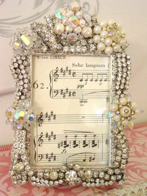 Frame of vintage jewelry; possibly a good way to use/preserve some old jewelry from my mom & grandmother