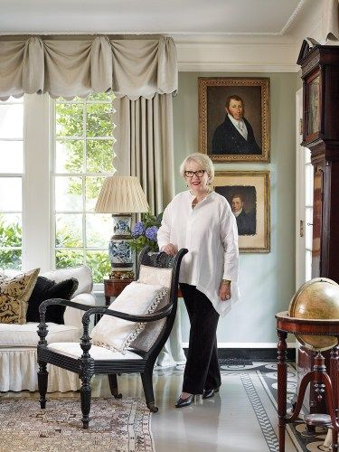 Jackye Lanham's living room defines her calm, cool, and collected style with its mix of antiques, blue-and-white porcelains, stately portraits, and soft color palette.