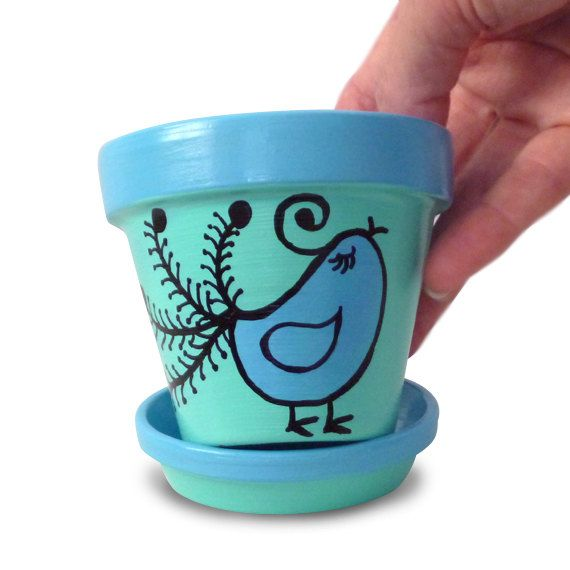 Hand Painted Flower Pot in Blue And Aqua With A Whimsical Bird - 3-inch pot. $12.00, via Etsy.