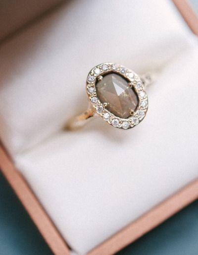 Oval Rose Cut Gray Diamond & Diamond Halo: http://www.stylemepretty.com/2015/05/16/23-vintage-inspired-engagement-rings/