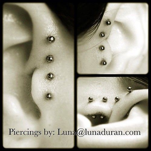 Very pretty double forward helix and double tragus. Definitely a fresh take.