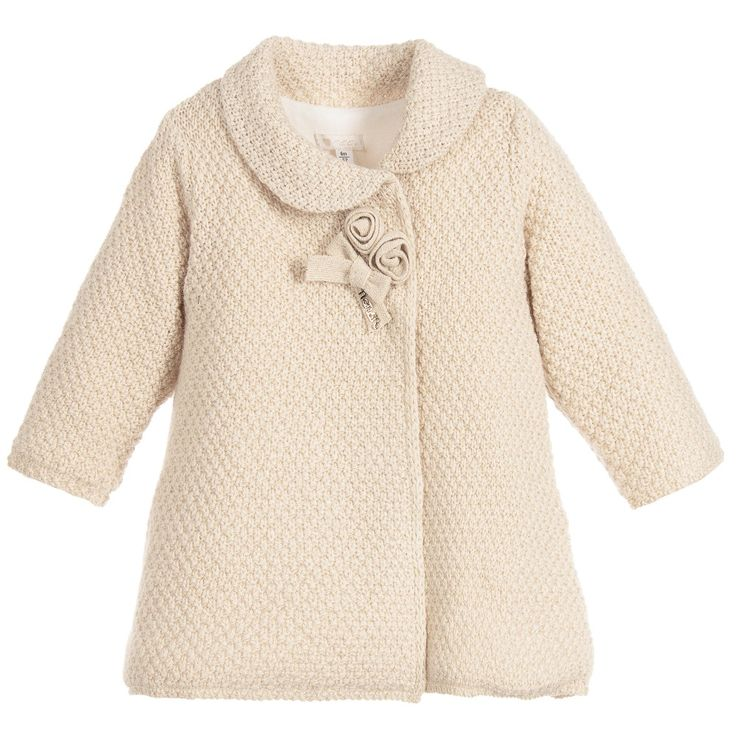 Girls beautiful beige, knitted coat, made in a luxurious cashmere and wool blend, with sparkling, gold lurex running through the weave. It features pretty, knitted roses and a bow at the neck, withNanán's gold, metal logo. Itfastens with large, concealed poppers and is fully lined in soft, cotton jersey.