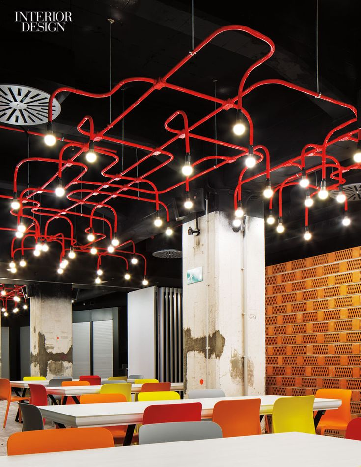 Design Agency added a riot of colorful light fixtures beneath the aluminum louvers of a converted 1960s office building in Barcelona, Spain, now an outpost of the Generator hostel chain. Photography by Nikolas Koening.