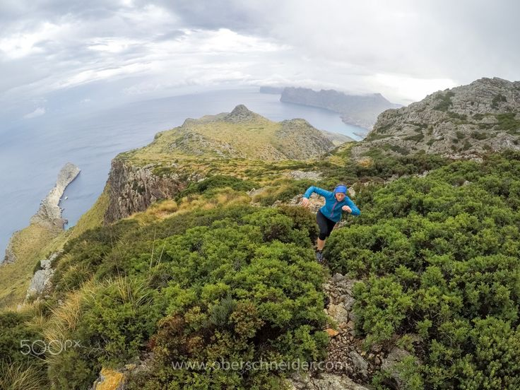 "Trail Running above the Coast of Mallorca - Mallorca, Spain.  Image available for licensing.  Order prints of my images online, shipping worldwide via  <a href=""http://www.pixopolitan.net/photographers/oberschneider-christoph-a6030.html"">Pixopolitan</a> See more of my work here:  <a href=""http://www.oberschneider.com"">www.oberschneider.com</a>  Facebook: <a href=""http://www.facebook.com/Christoph.Oberschneider.Photography"">Christoph Oberschneider Photography</a> follow me on <a…"