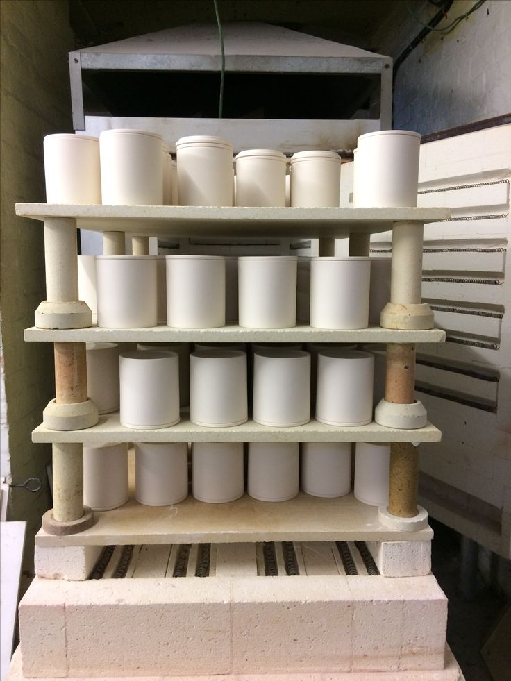 Candle jars coming out of the kiln from the first firing. Ready to be glazed and then back in to the heat to complete them.