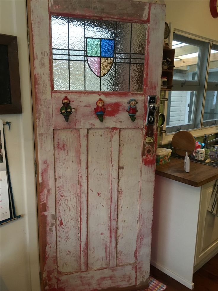 Other side of the back door. The hooks are of little red riding hood, the wood chopper and granny.