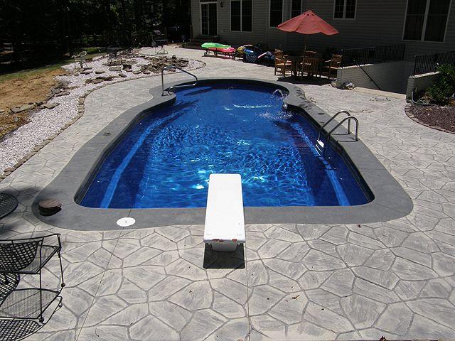 Grey Stamped Concrete Deck With Darker Grey Coping