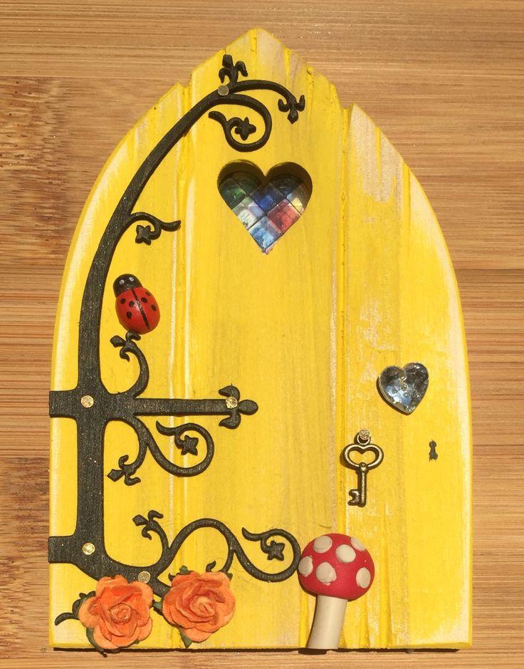 Oaktree Fairies - The Welsh Fairy Door Company. Summer Yellow Fairy Door with new Fairytale hinge! www.oaktreefairies.co.uk
