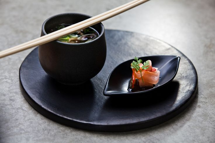 Saiko miso - White miso soup with mustard, seaweed, shimeji mushrooms, tofu and edamame. Served with pickled vegetable.