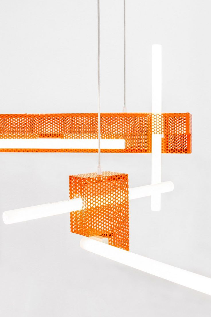 <p>Made of folded and lacquered micro-perforated sheets, the 'Entreplanta Lighting' collaboration between designer Marta Ayala Herrera and architect Cito Ballesta, is a collection of industrial lamps
