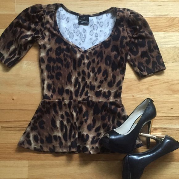 Modcloth Peplum Leopard Top You're one ebullient citizen when you reside in this leopard peplum top! In addition to a sprinkling of spots set atop a taupe backdrop, this knit shirt boasts smile-inspiring amounts of fierceness in its pleated shoulders and a flattering, angled silhouette. The scooped, sweetheart-esque neckline and flexible, formfitting fabric leaves you feeling 'purr'-fectly pleased, especially when paired up with a cherry-hued tulip skirt and noir peep toes. 80% Polyester…