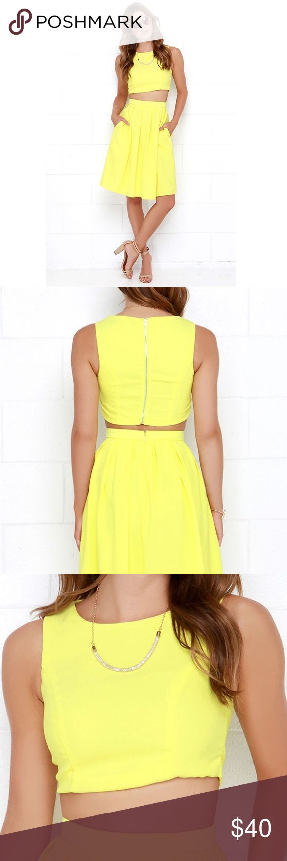 "LULU*S YELLOW TWO-PIECE MIDI DRESS Small As Seen On Alina of Styled by Alina blog! bright lemon yellow, woven fabric is shaped into a cropped, sleeveless bodice with a boat neck, princess seams, and exposed gold zipper at back. Matching skirt has cute box pleats above a full, midi-length hem with hidden back zipper and clasp. Fully lined. Small top measures 14.5"" long. Small bottom measures 24"" long. Self: 100% Polyester. Worn once for bridal shower, has been dry cleaned Lulu's Dresses Midi"