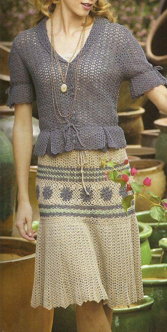 This skirt & blouse set is crocheted in a fine crochet thread. The blouse has a delicate design with a tiny folded collar, short sleeves that end with a flourish of lace with a drawstring cuff. The bodice has a feminime peblum that flows over a knee-length skirt. The skirt is