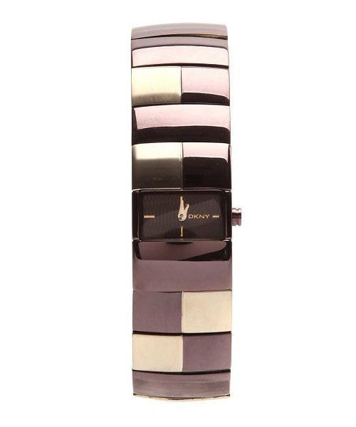 DKNY Women's Dressy Brown and Gold. I love this sleek sophisticated watch. It has a soft pearlized finish to it. Donna Karan makes gorgeous watches.