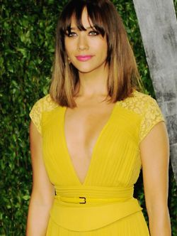 Rashida Jones, radiant in neon yellow and bright pink lips.