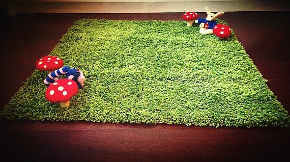 Soften things up with an Alice in Wonderland–inspired rug. | 33 Perfectly Subtle Ideas For Your Disney-Themed Nursery